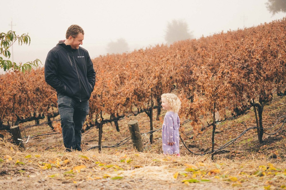 Ryan and his daughter standing in a vineyard