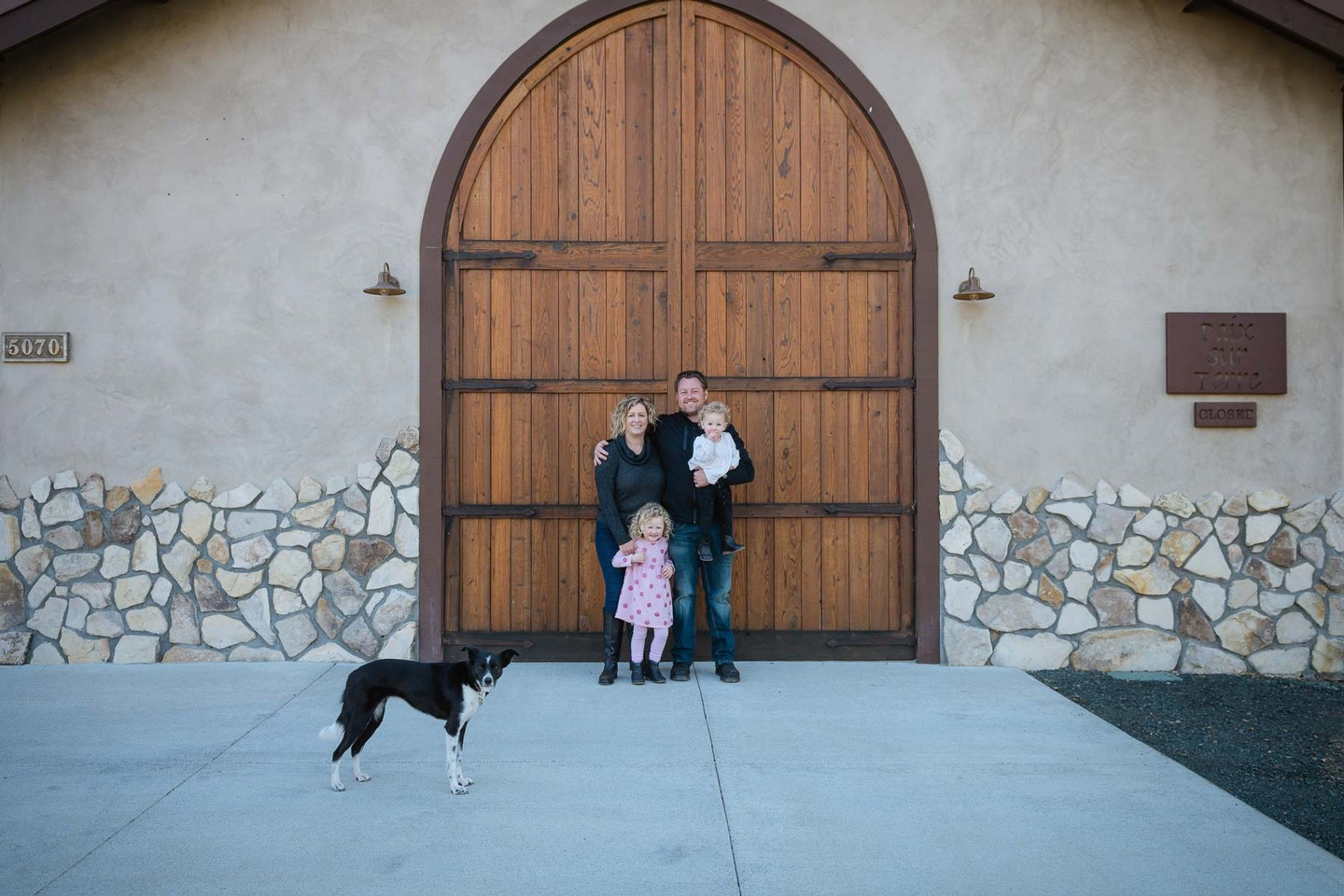 The Pease family standing in front of the tasting room
