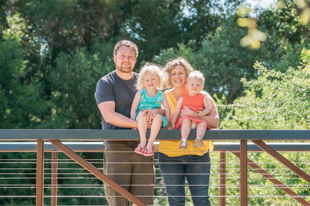 The Pease family posing on a bridge